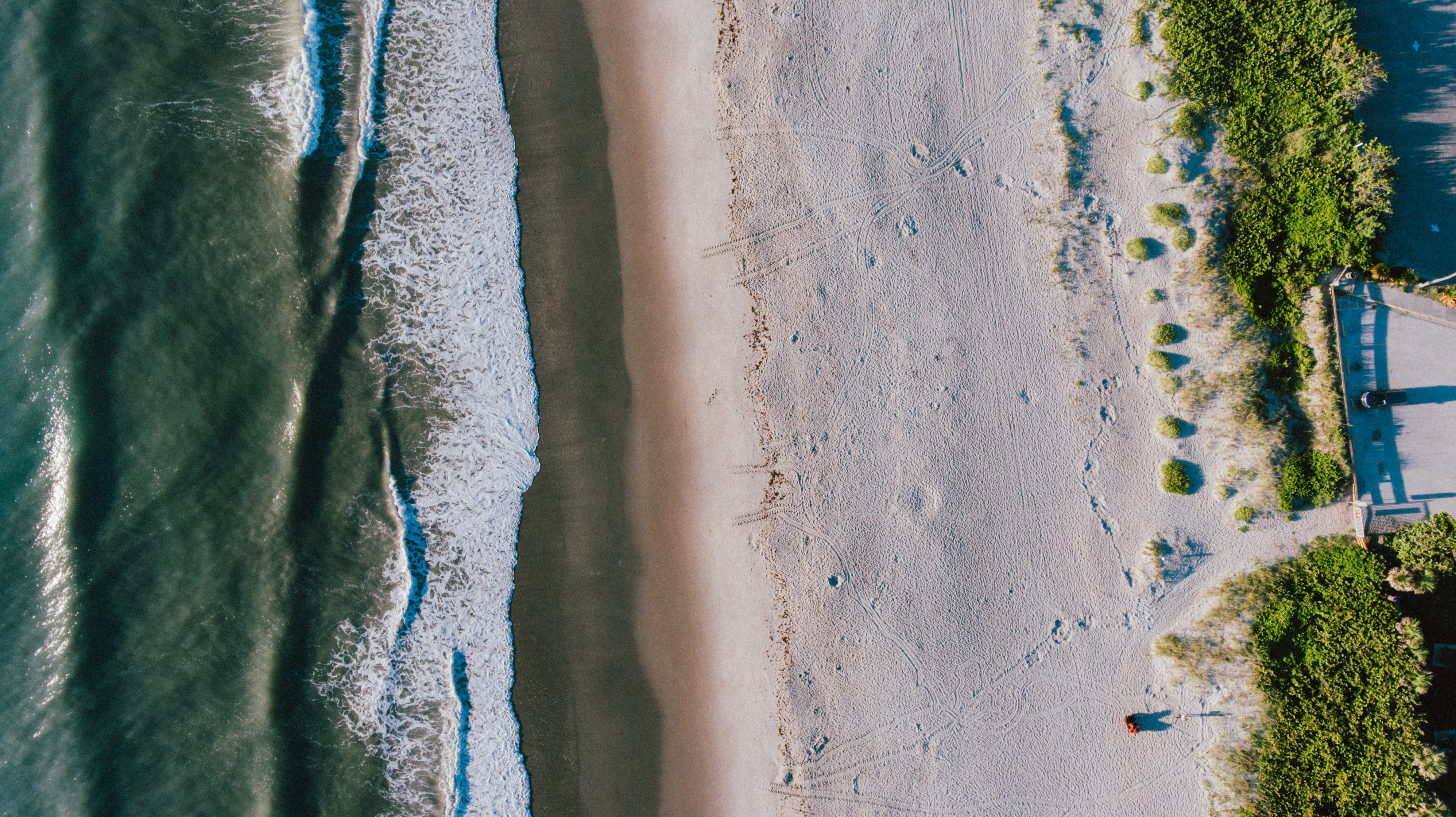 Drone aerial view of the sand Melbourne Beach coastline
