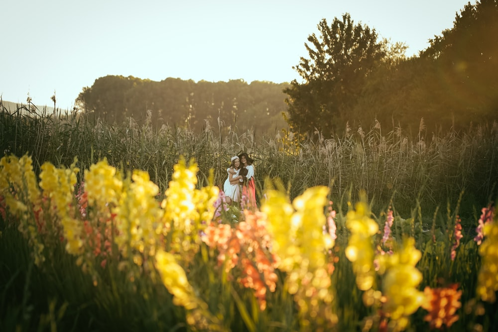 two woman in the middle of lavender fields