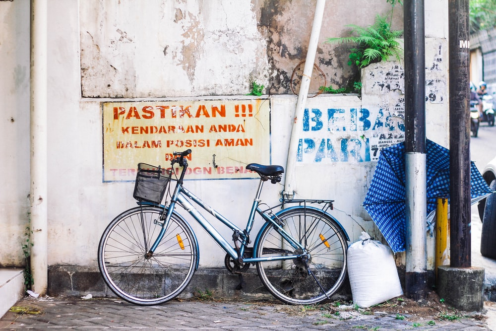 blue bicycle near wall