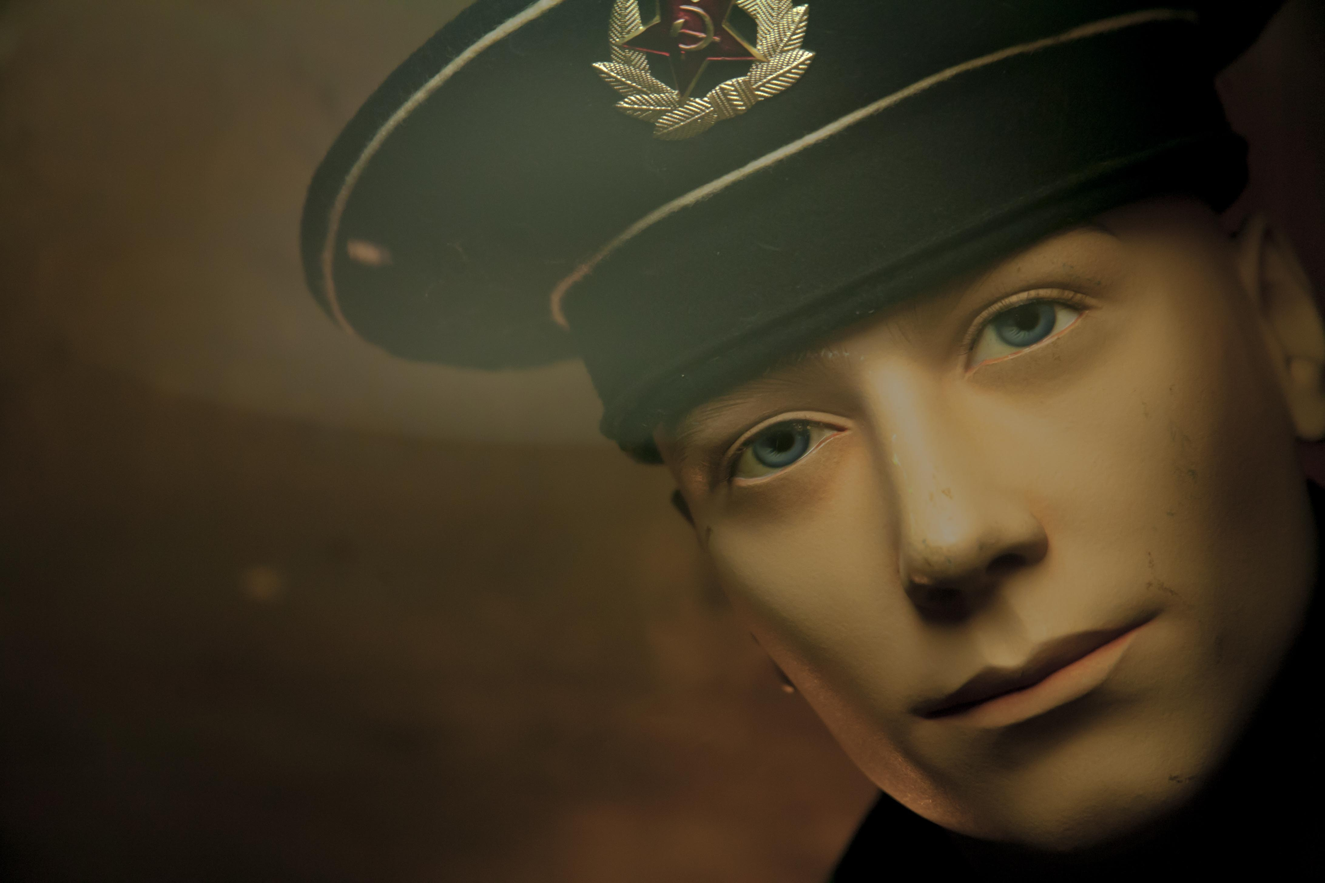 A mannequin dressed as a sailor wearing a hat in U-Boat Museum, Hamburg GmbH