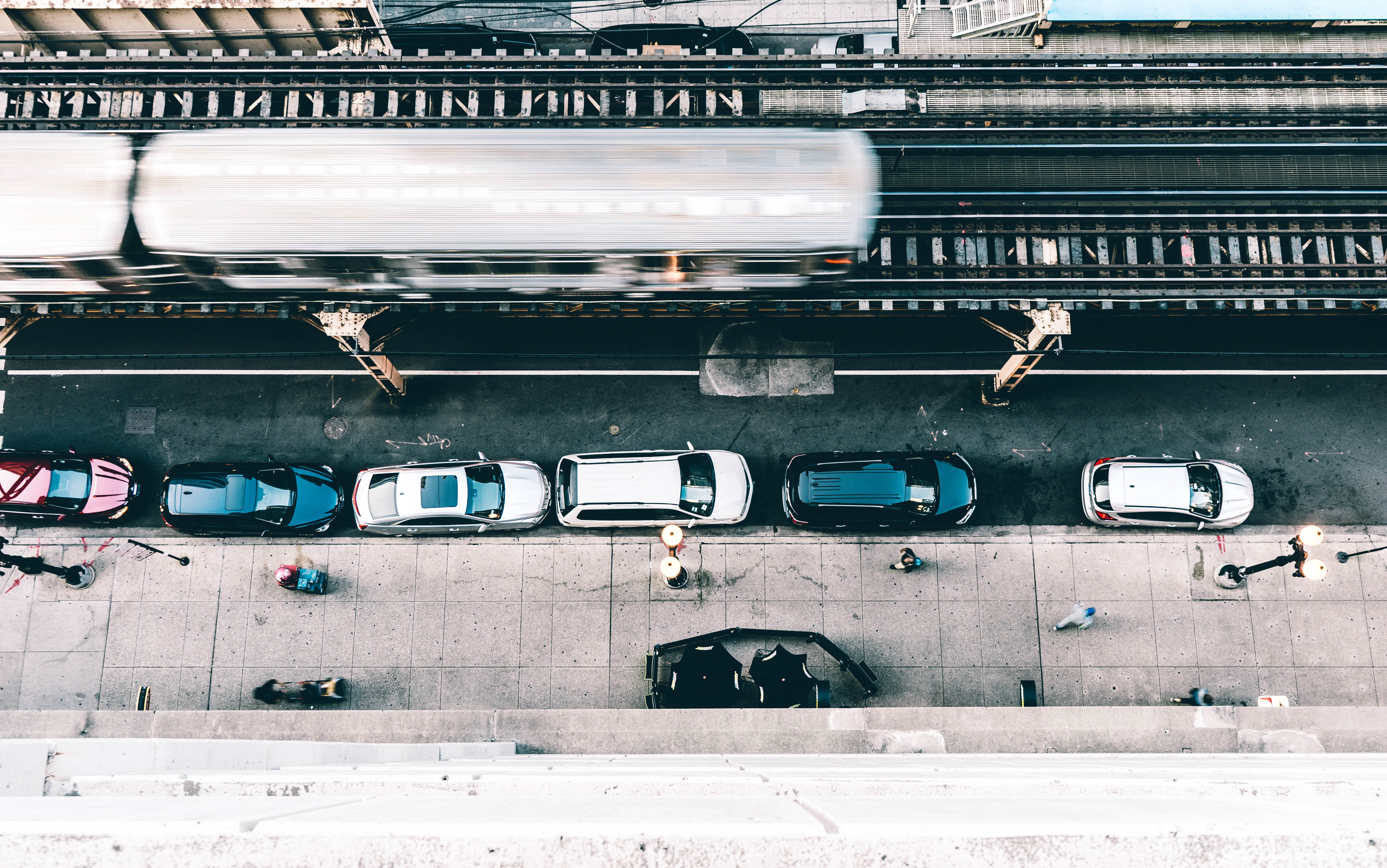 flat lay photography of cars parked beside building