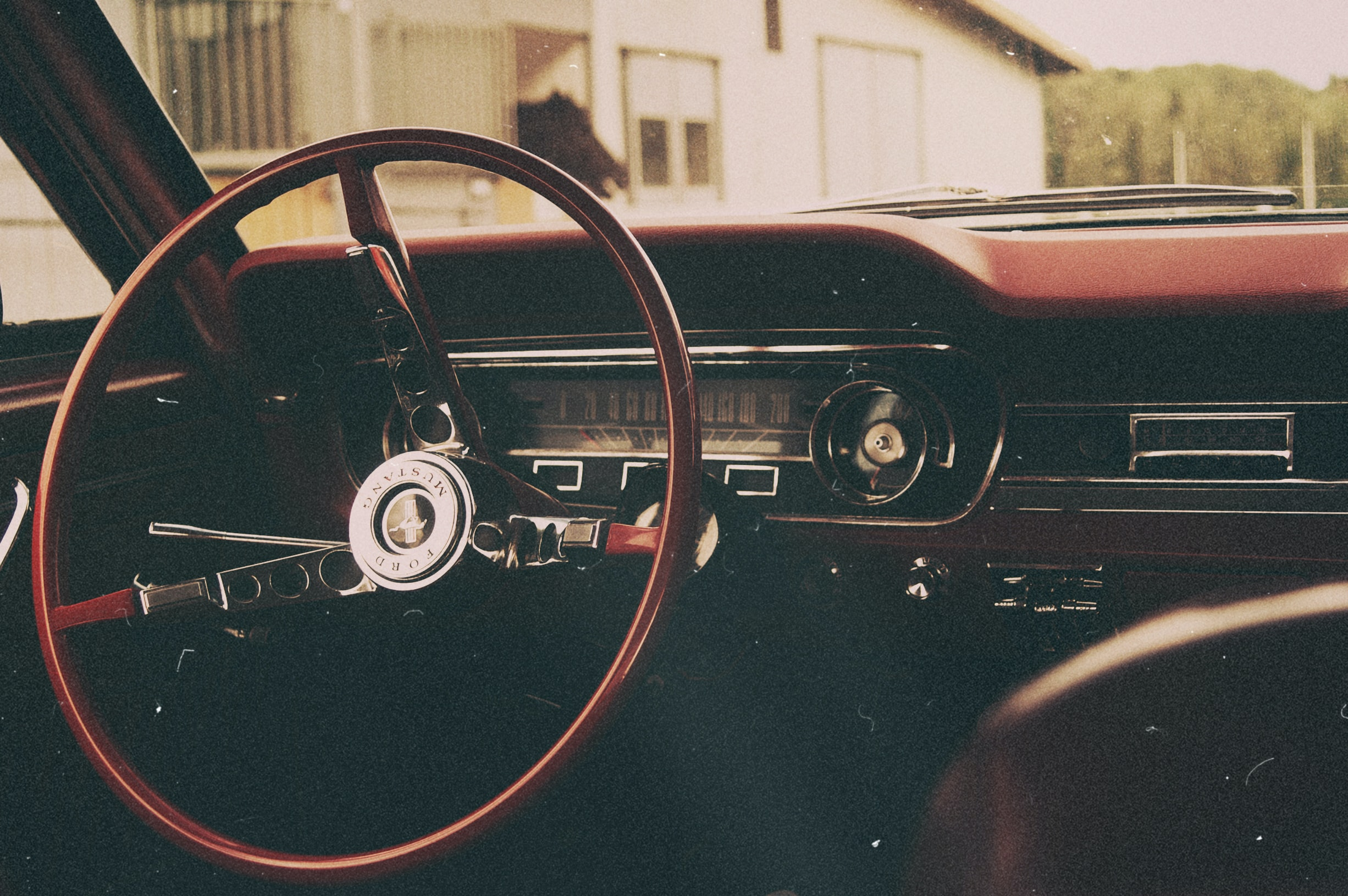 Ford Mustang Vintage Automobile Car Interior Shot Focusing On The Thin  Wheel With A Barn Of