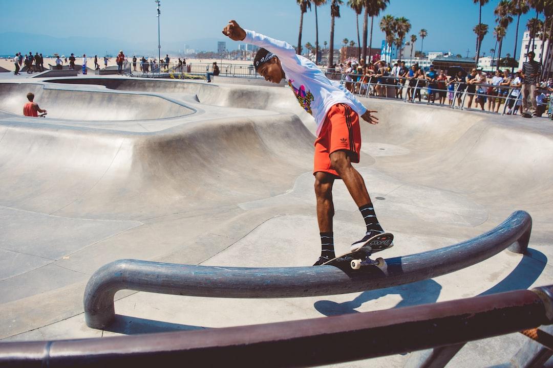 Frontside board slide at the Venice Beach skatepark.