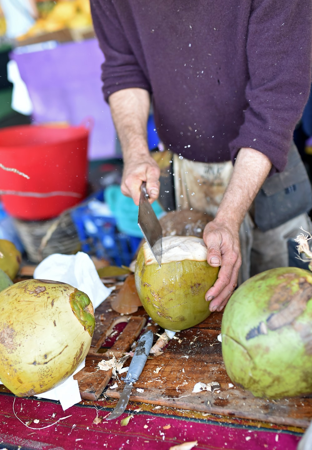 man slicing coconut