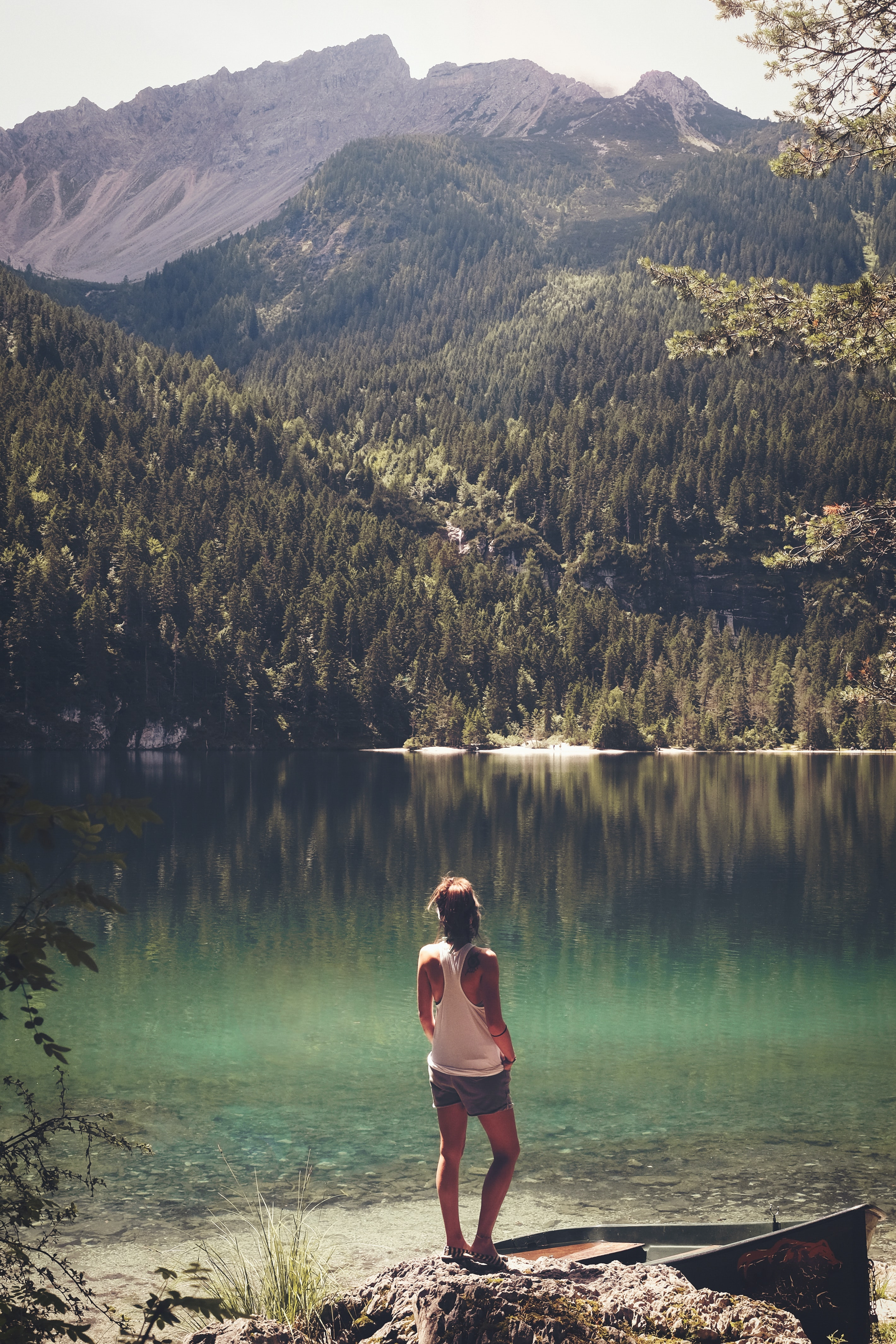woman standing in front of body of water