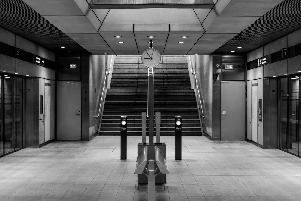 grayscale photo of building stairs