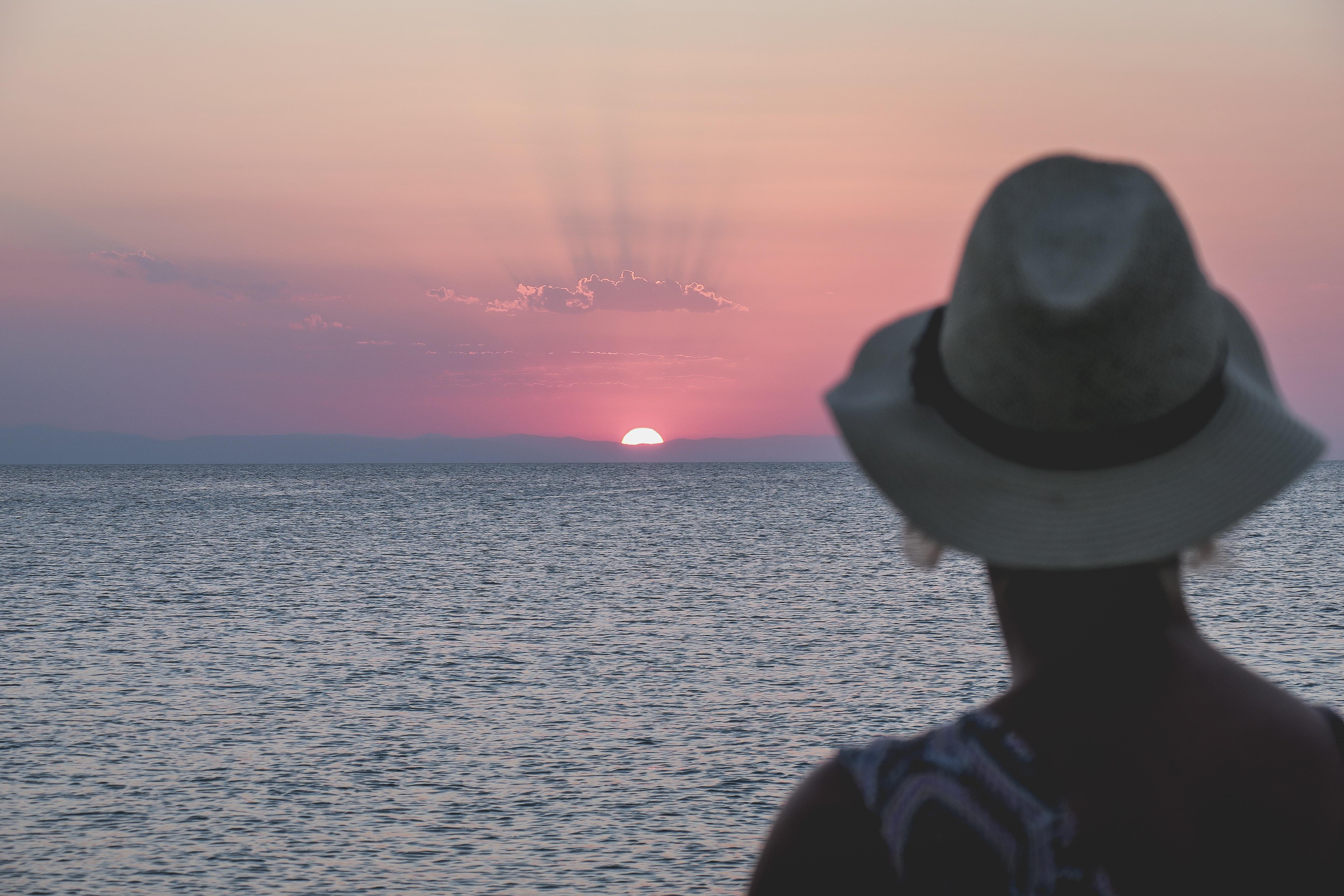 woman facing sunset