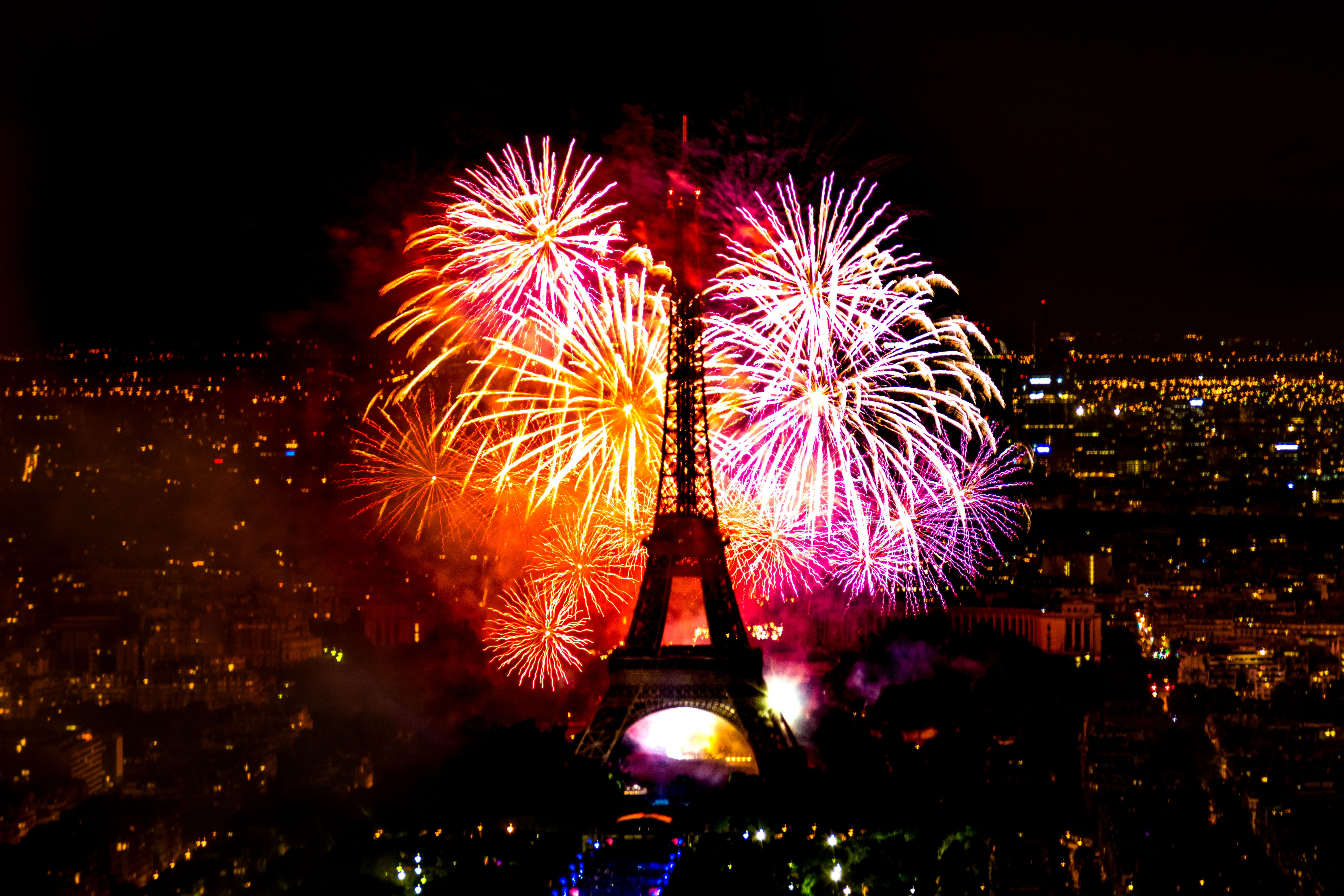 A fireworks display behind the Eiffel Tower in France.