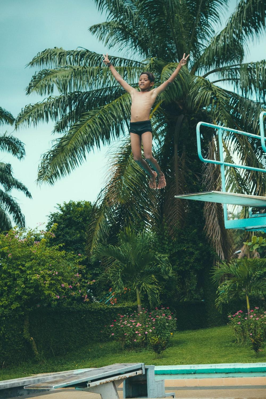 boy jumping oin pool