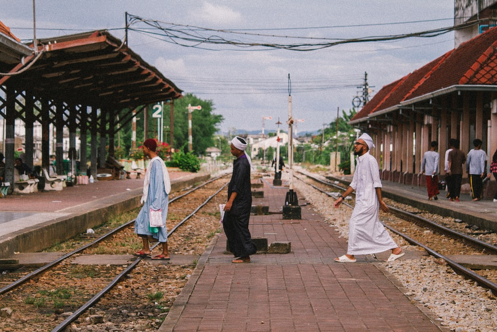 three man crossing streets