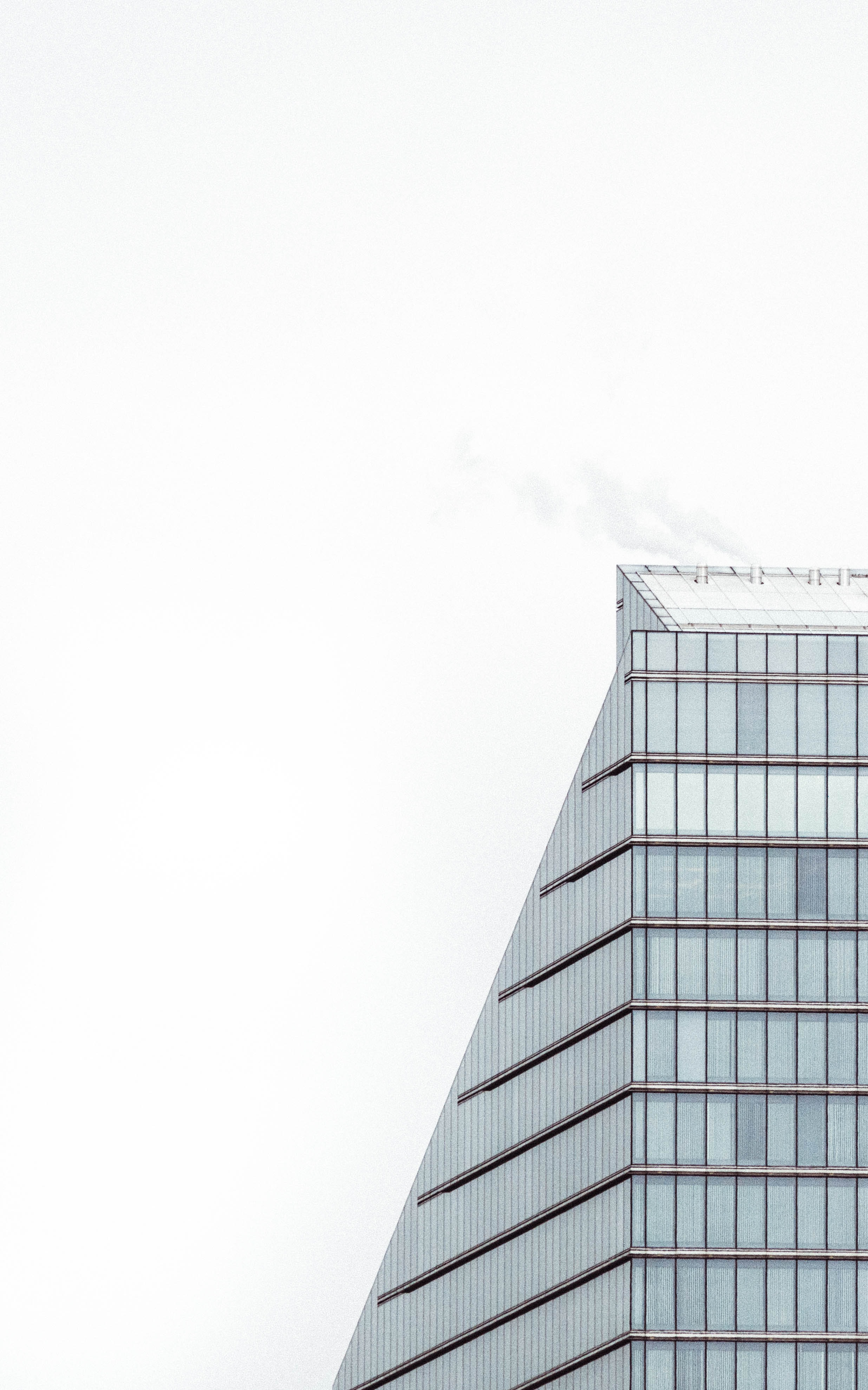 The edge of a building facade with glass-to-ceiling windows