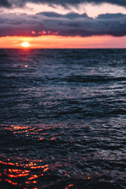 body of water in golden hour background