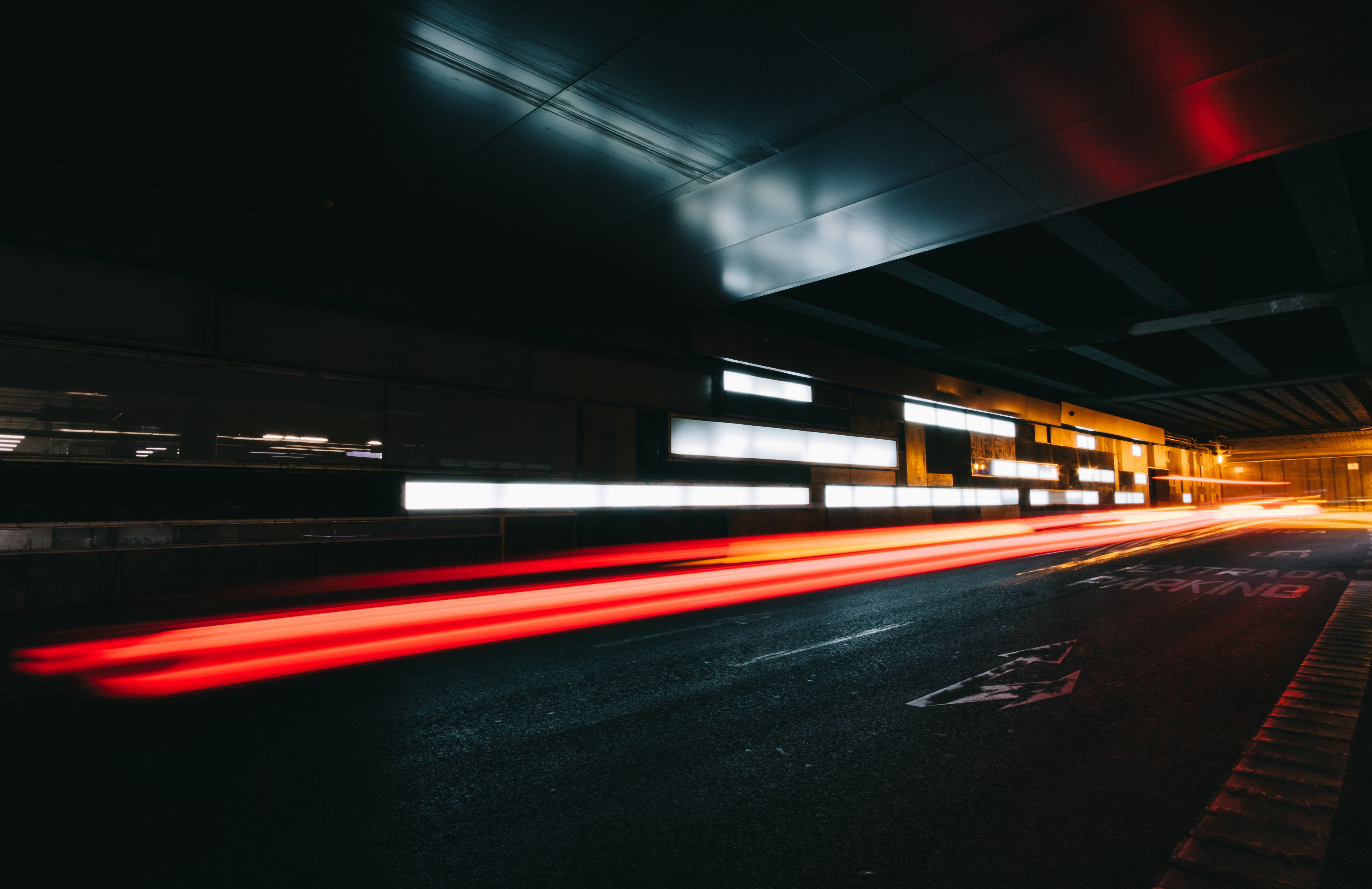 Red light trails in an urban tunnel in Madrid