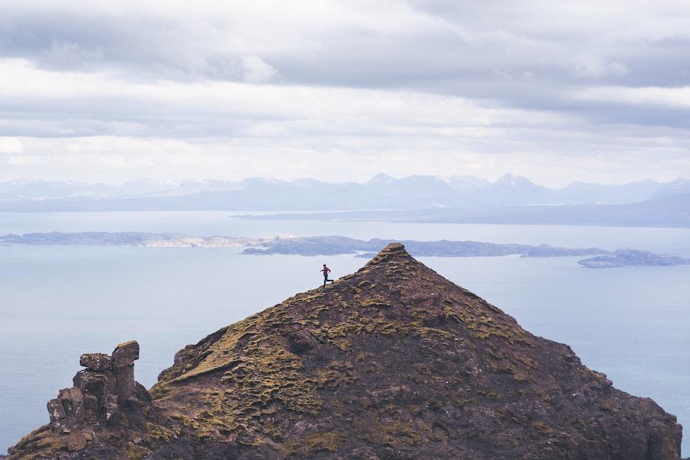person walking on brown mountain