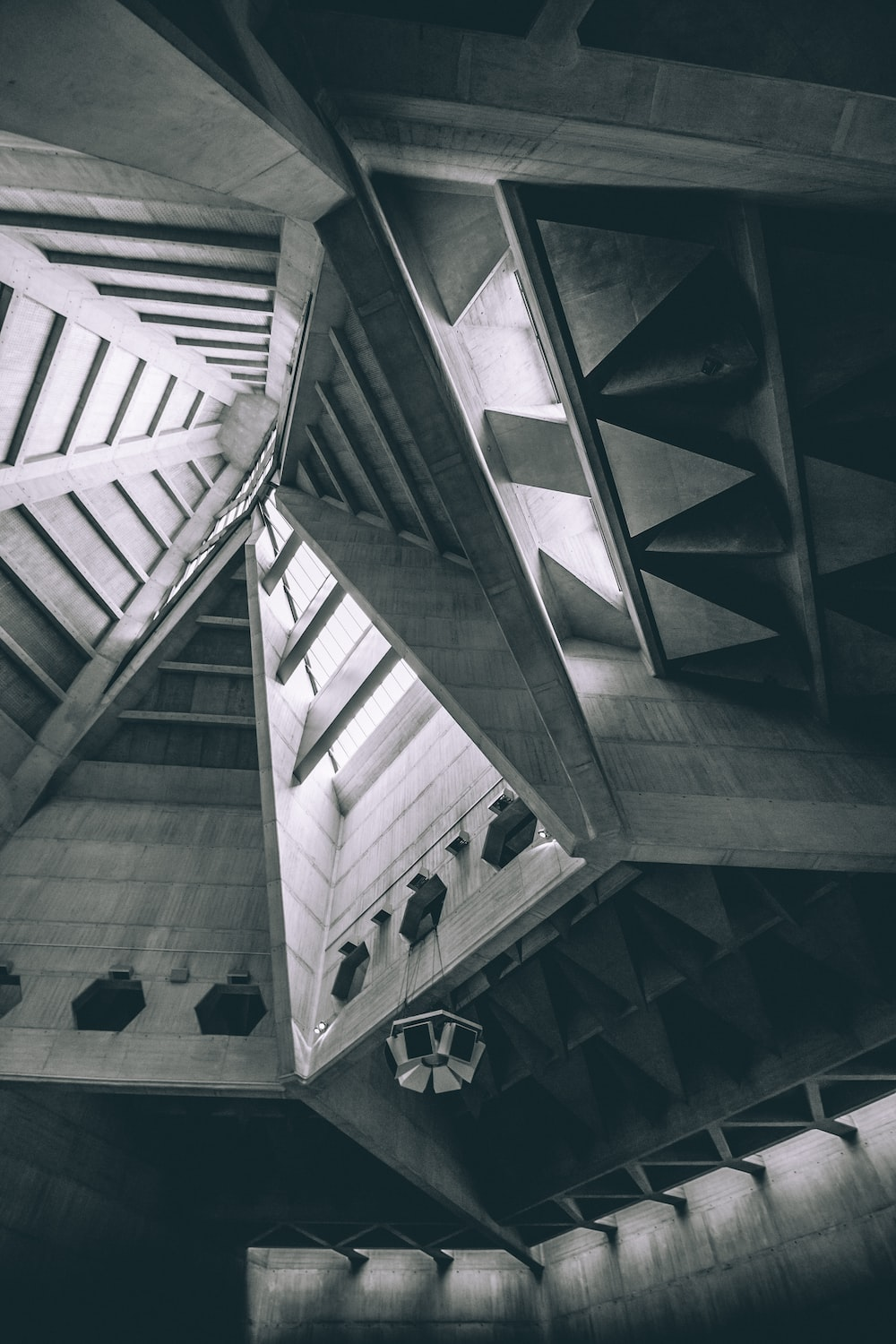 greyscale photo of wood ceiling