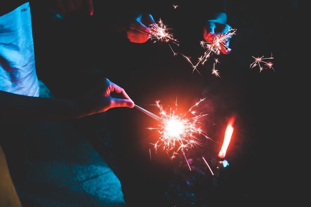 people holding sparklers