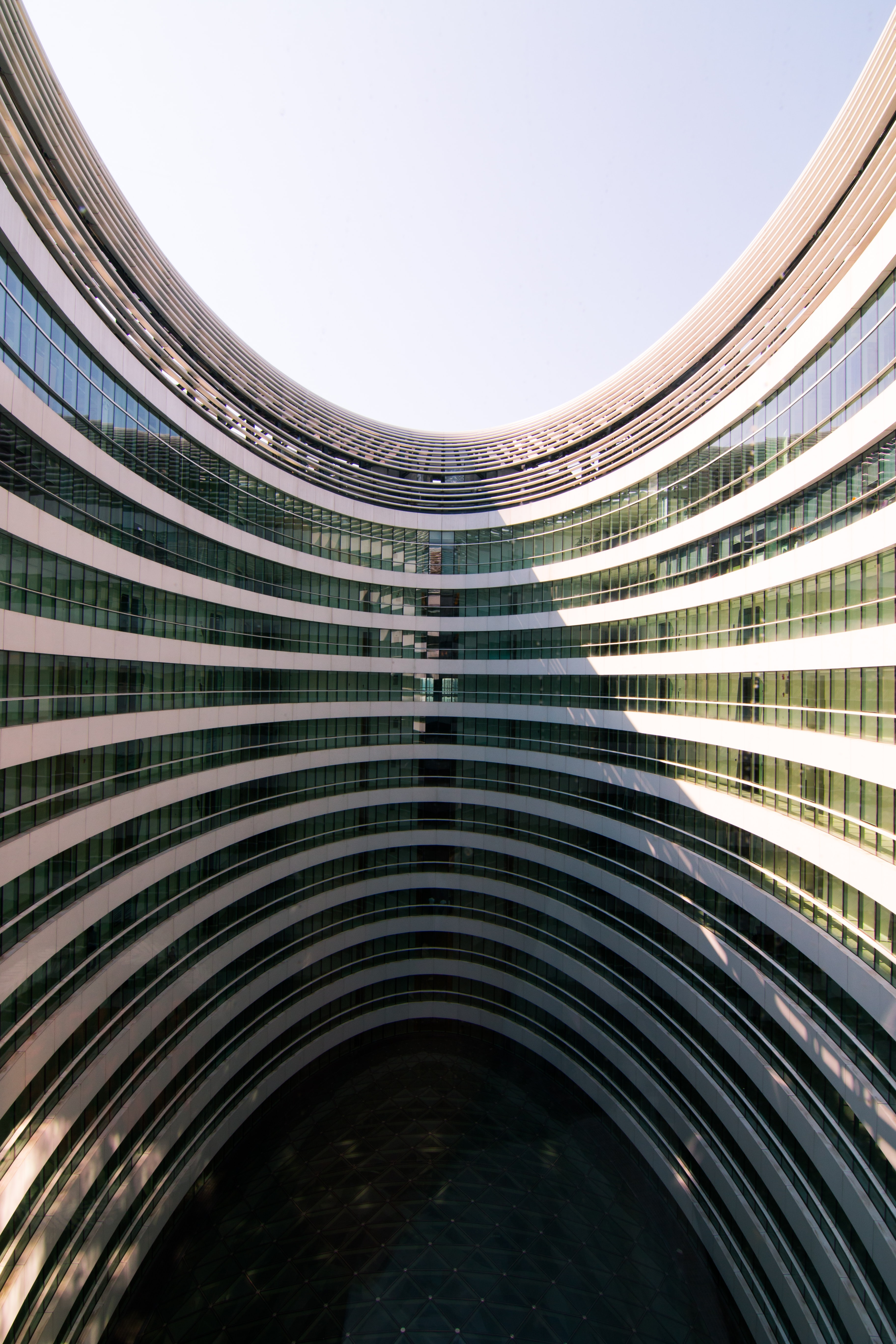 The courtyard of a curving office building