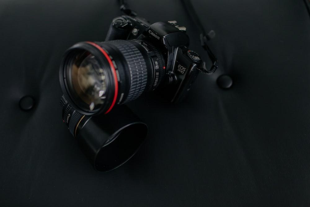 black Canon EOS DSLR camera