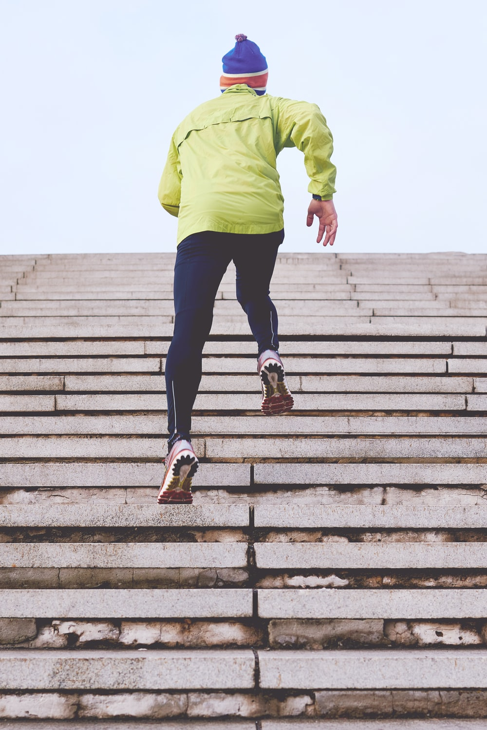 person climbing concrete stairs