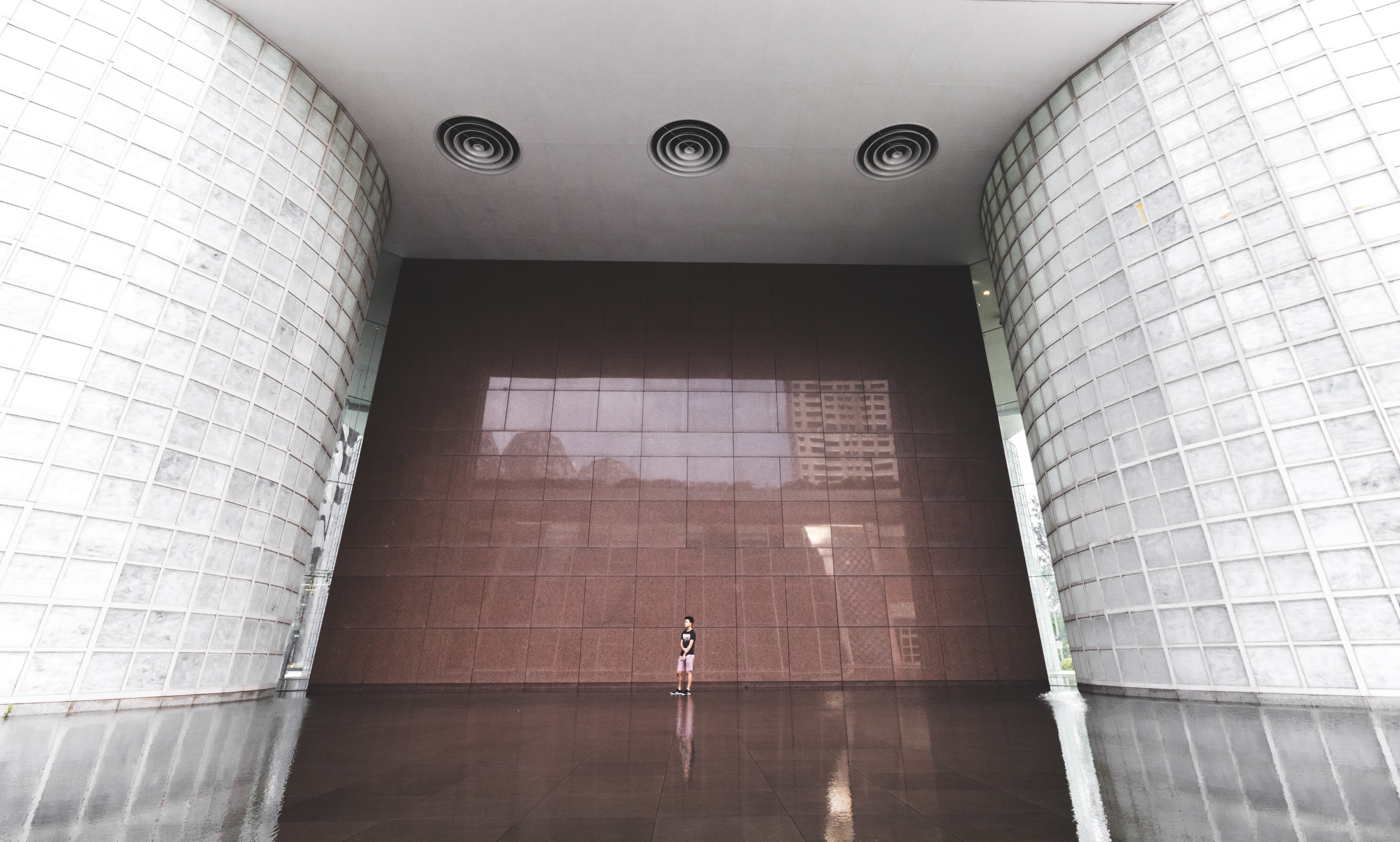 man standing inside building