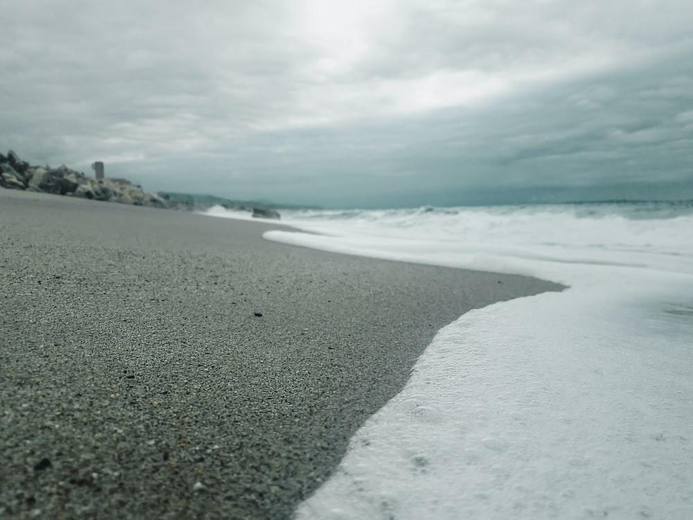 beach under cloudy sky