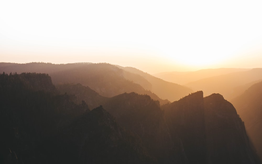 silhouette of mountain during dawn