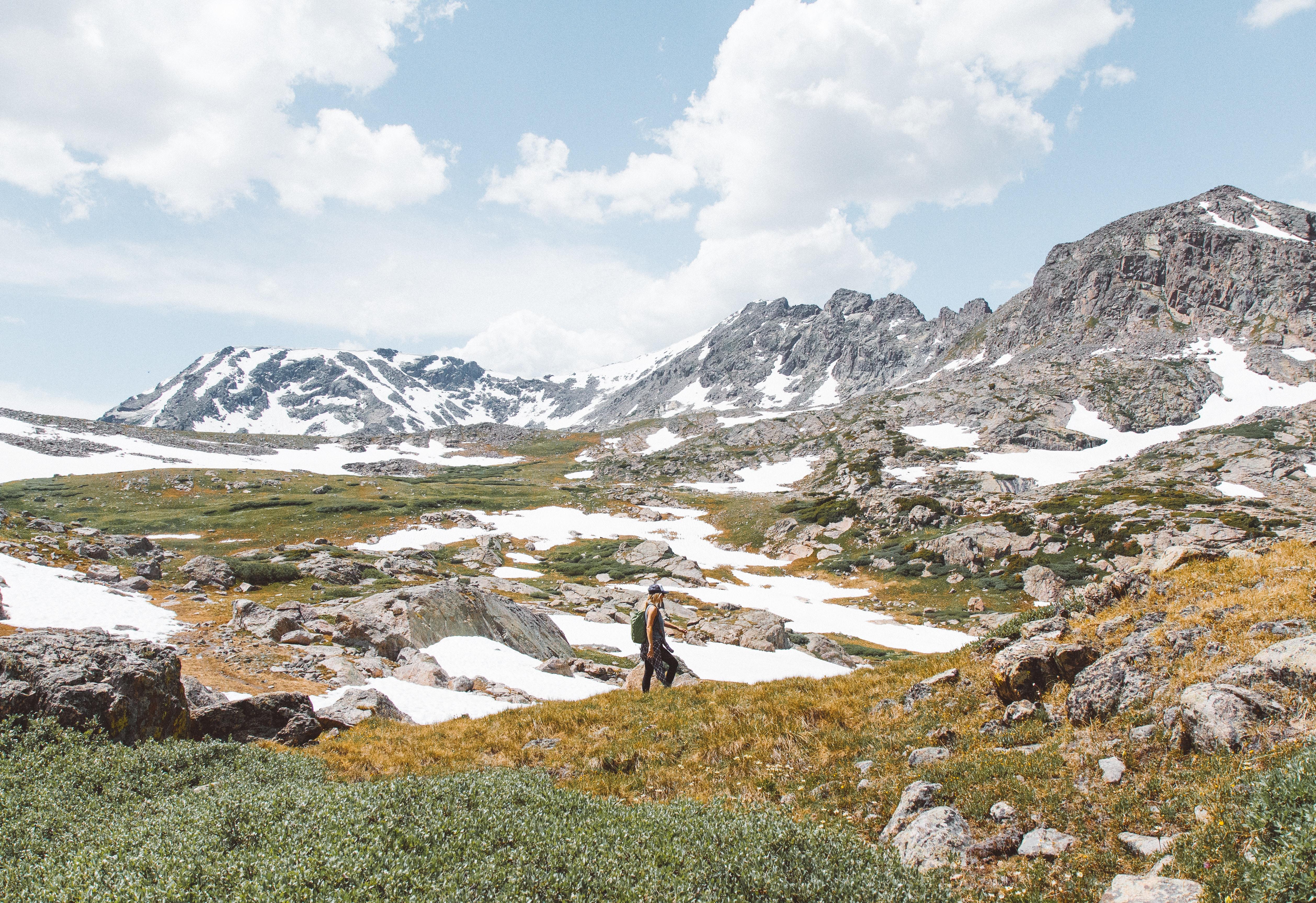 person walking near mountain