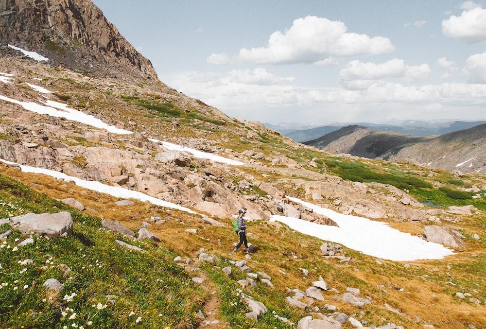 man walking on rock mountain