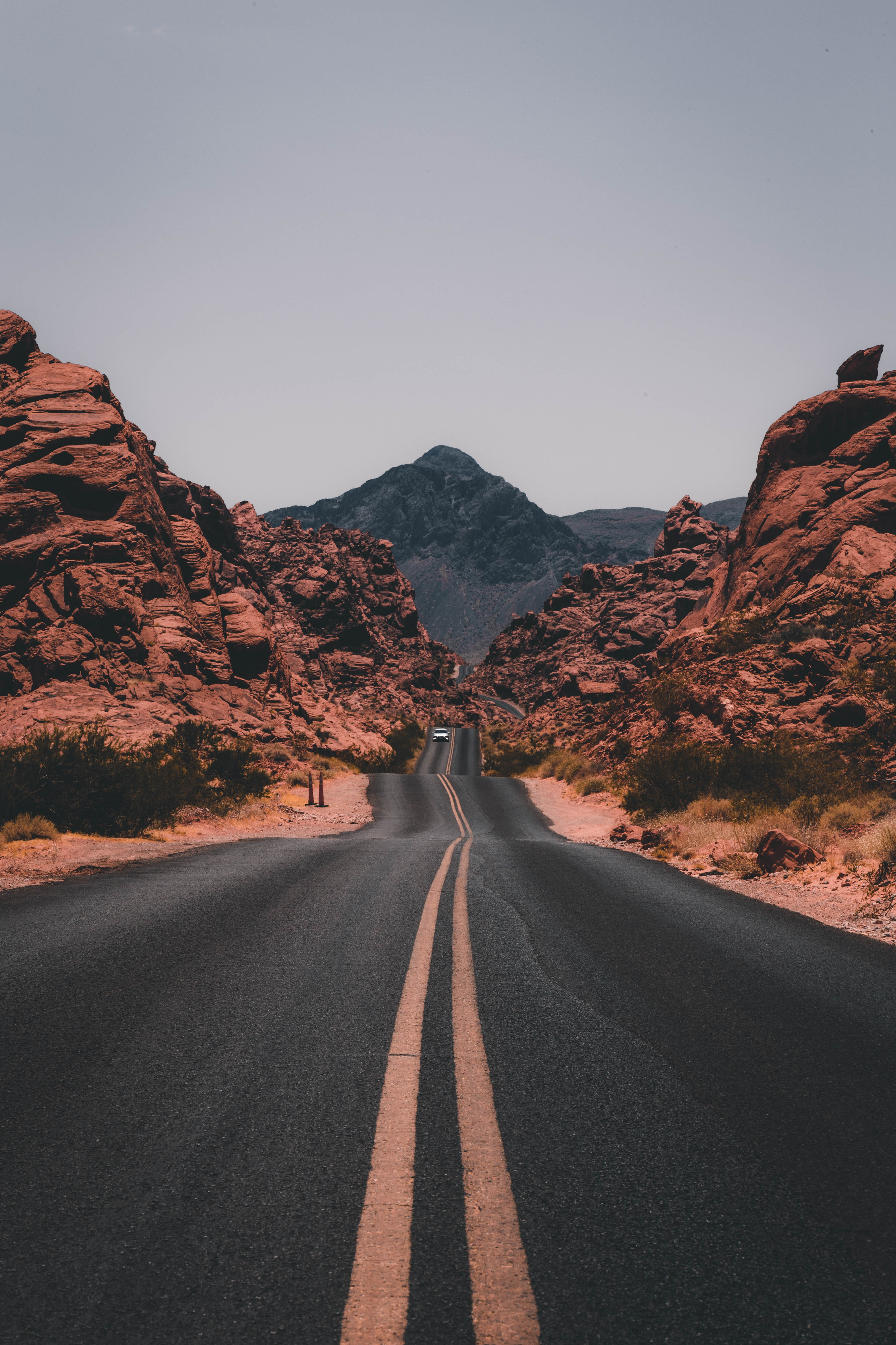 A highway road through rocky cliffs at Valley of Fire State Park