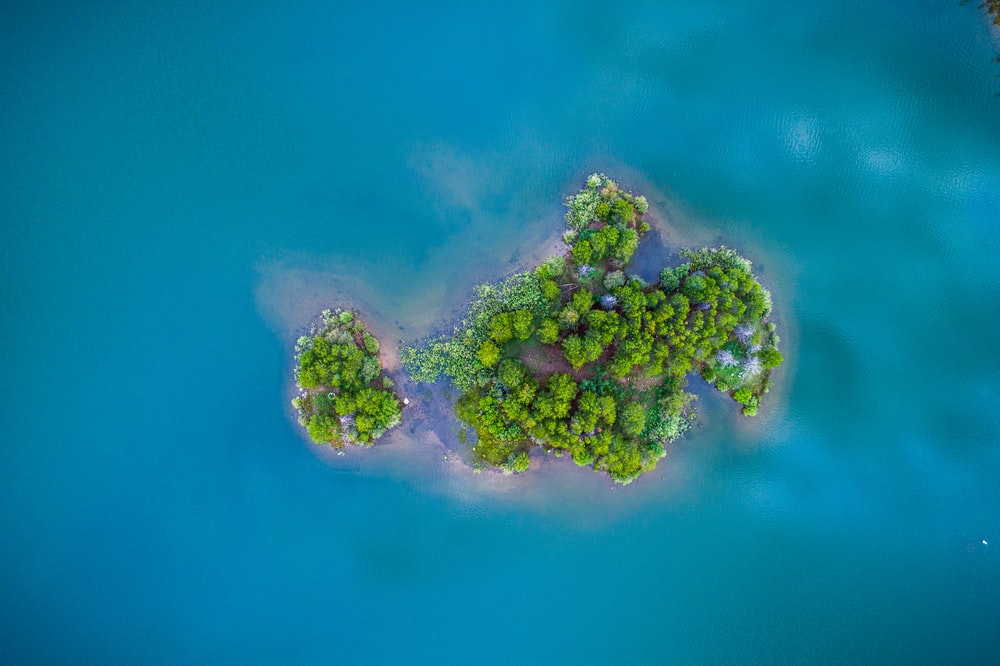 green island surrounded by body of water