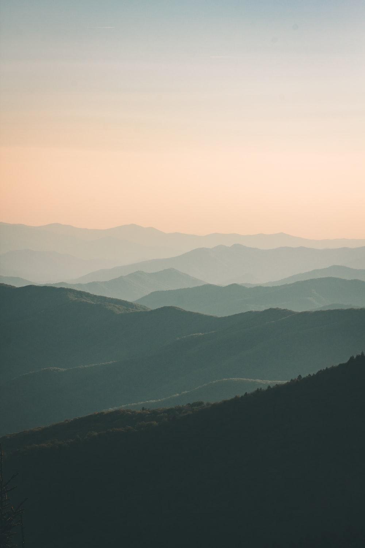 mountains under white mist at daytime