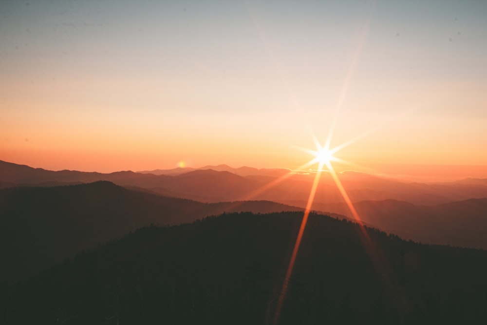 silhoutte of mountains during sunset