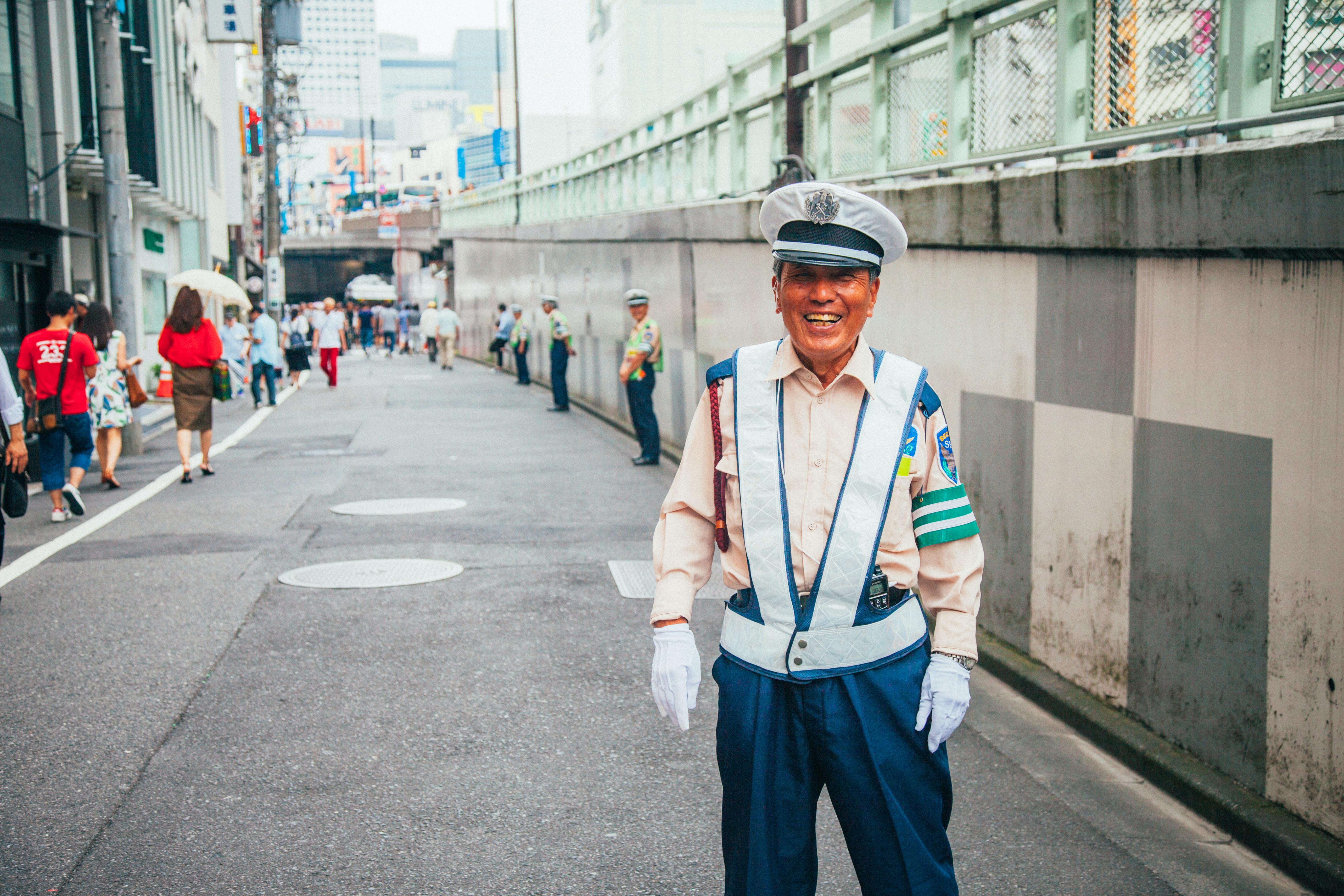 A smiling traffic cop on the street in Shinjuku Japan