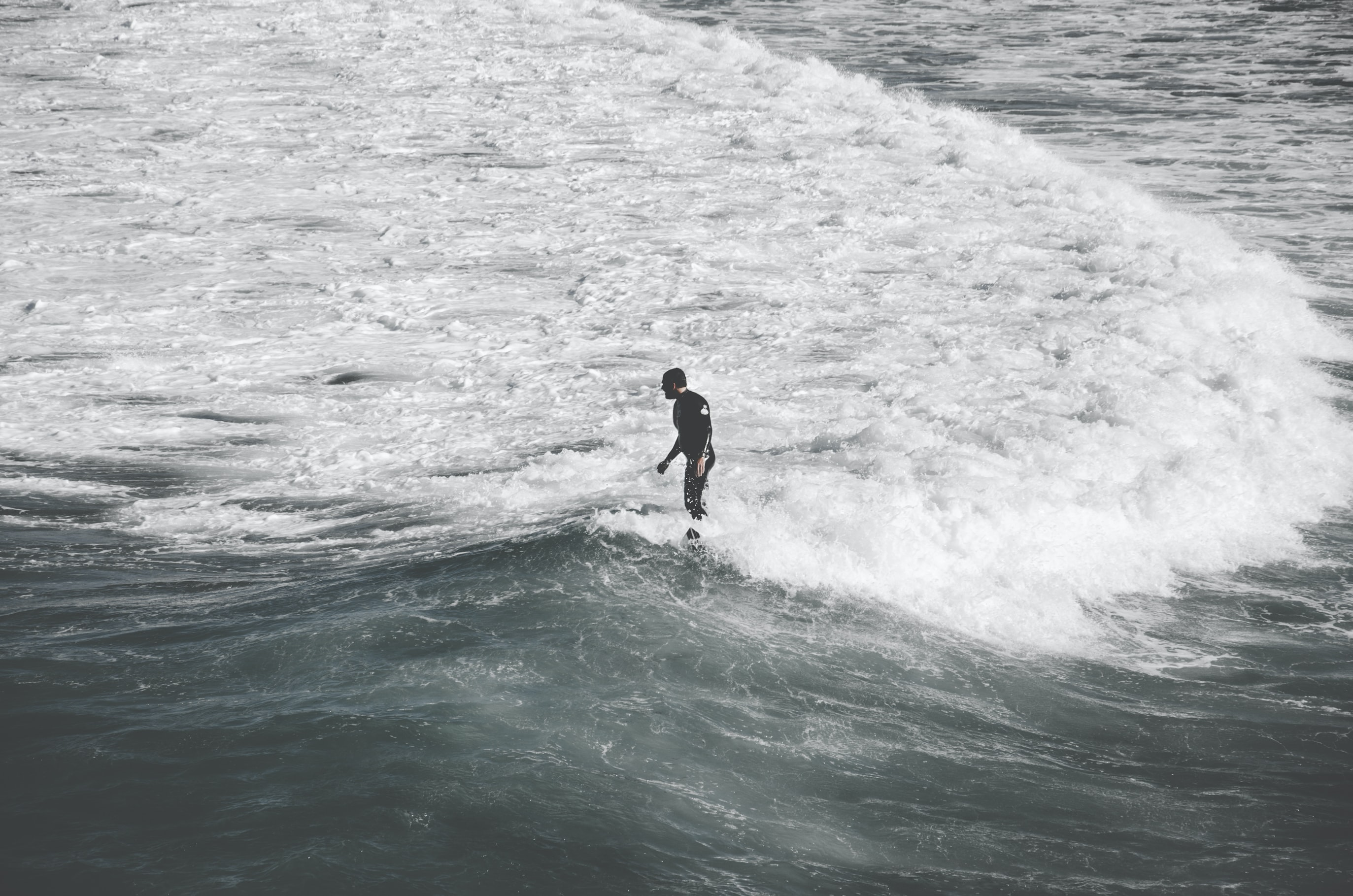 Person standing in the ocean shallow water waves