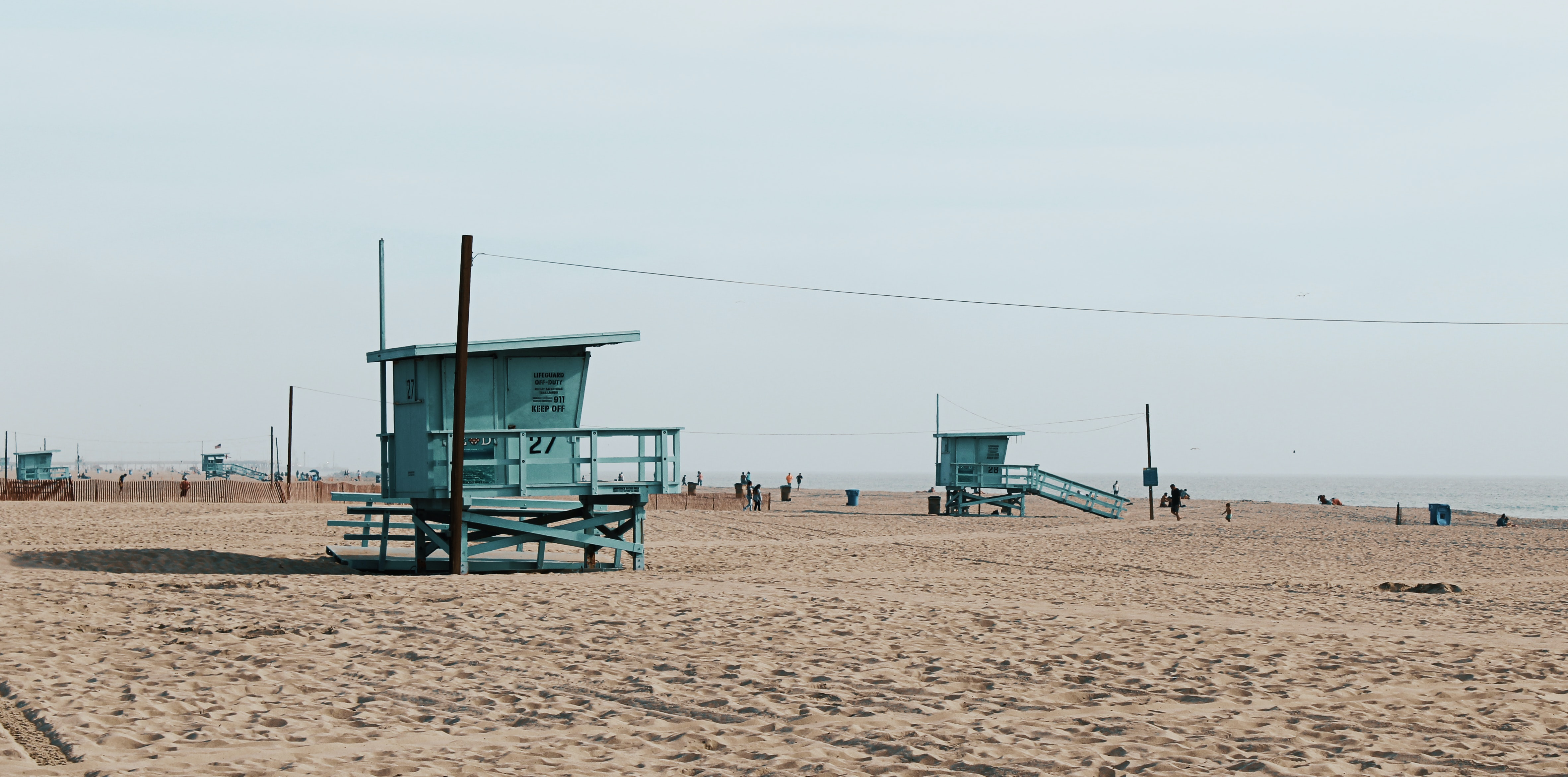 The Santa Monica beach with sand and turquoise lifeguard stands