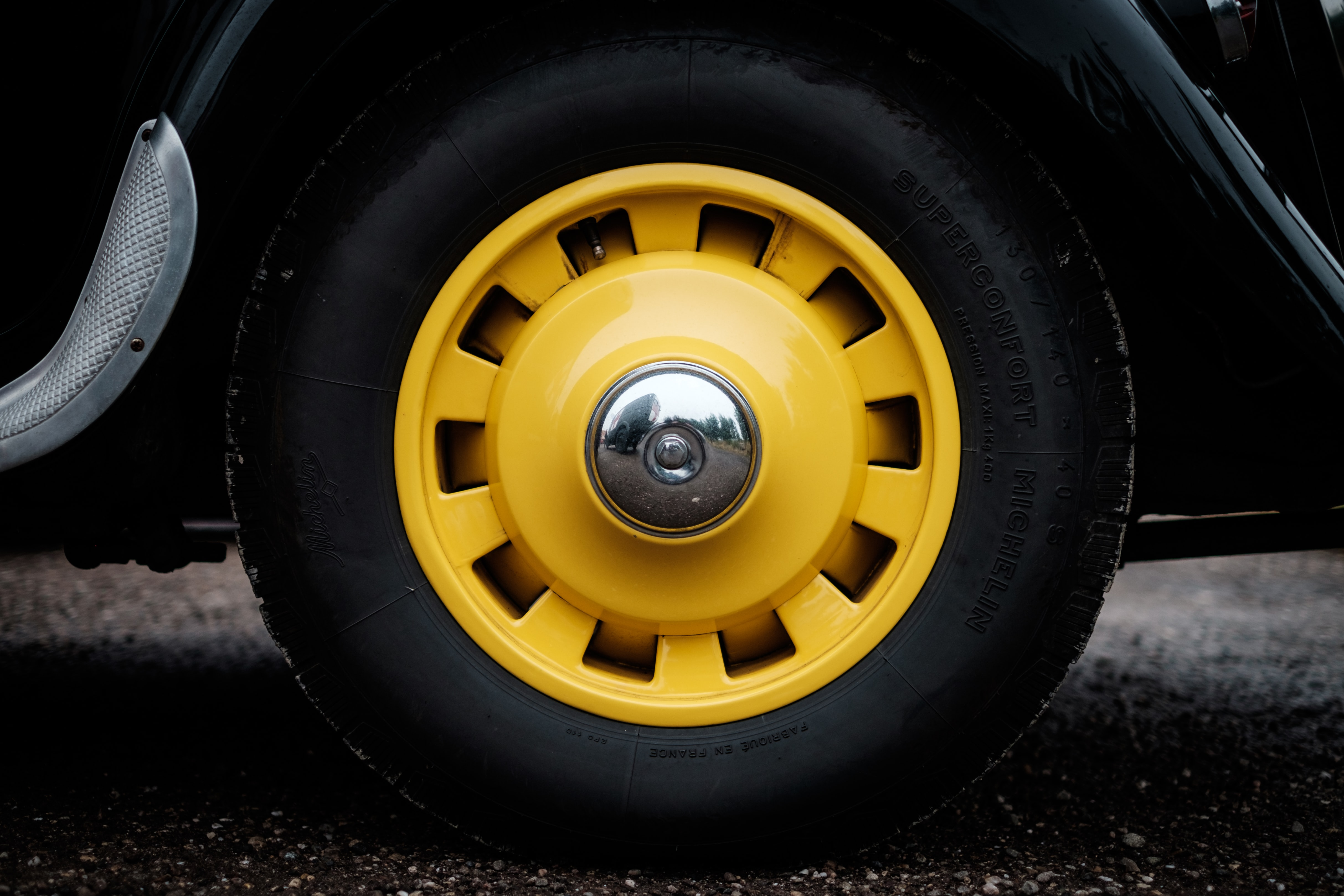 A black tire with a yellow hubcap in Colombey-les-Belles