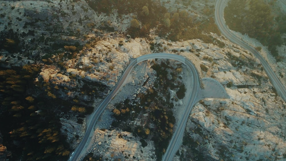 aerial photography of road and mountan