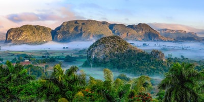 aerial photography of mountains and near trees during daytime cuba zoom background