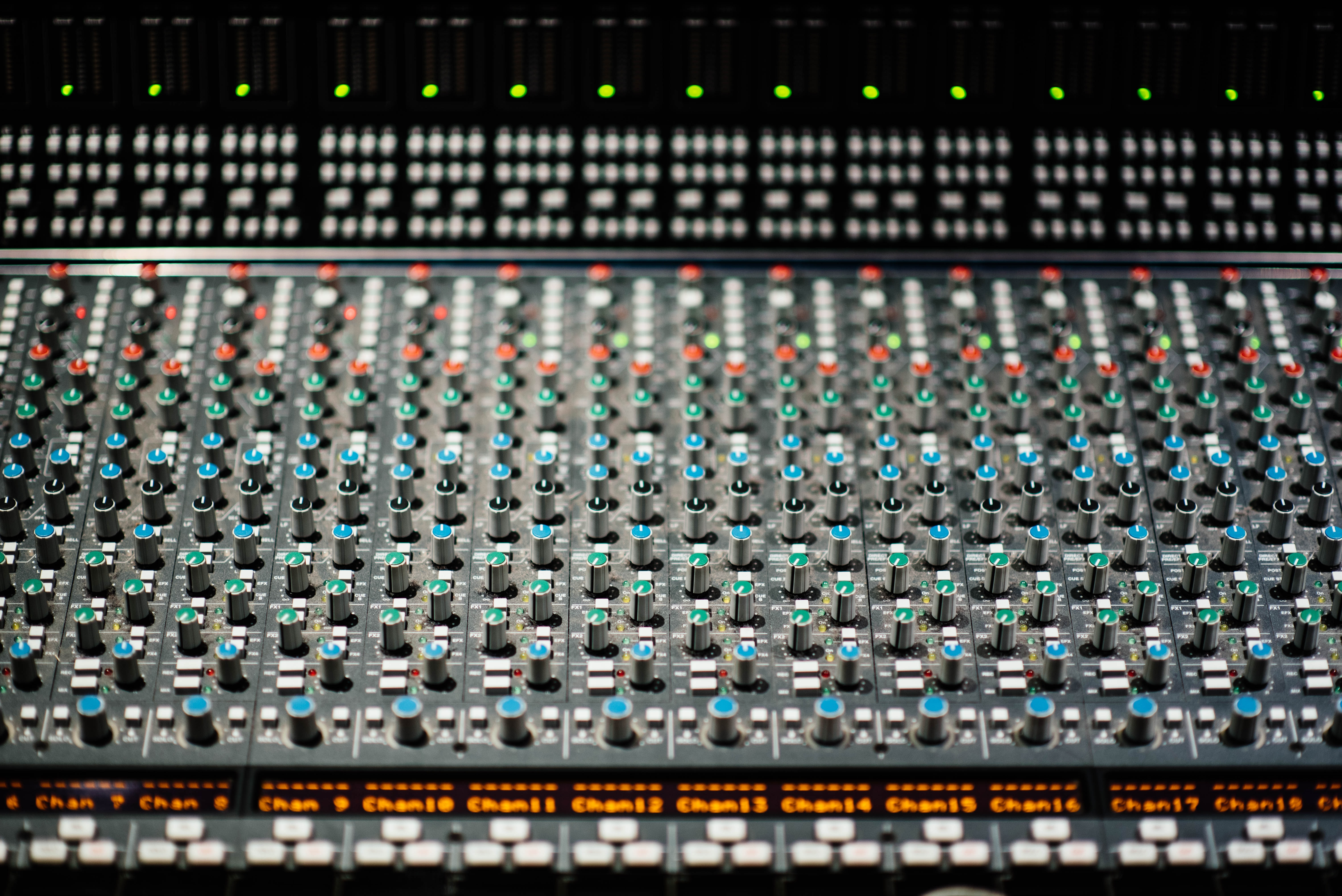 selective focus photography of black and red audio mixer