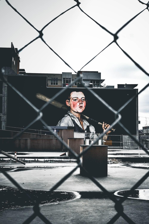 selective color photography of man holding baseball bat wall art