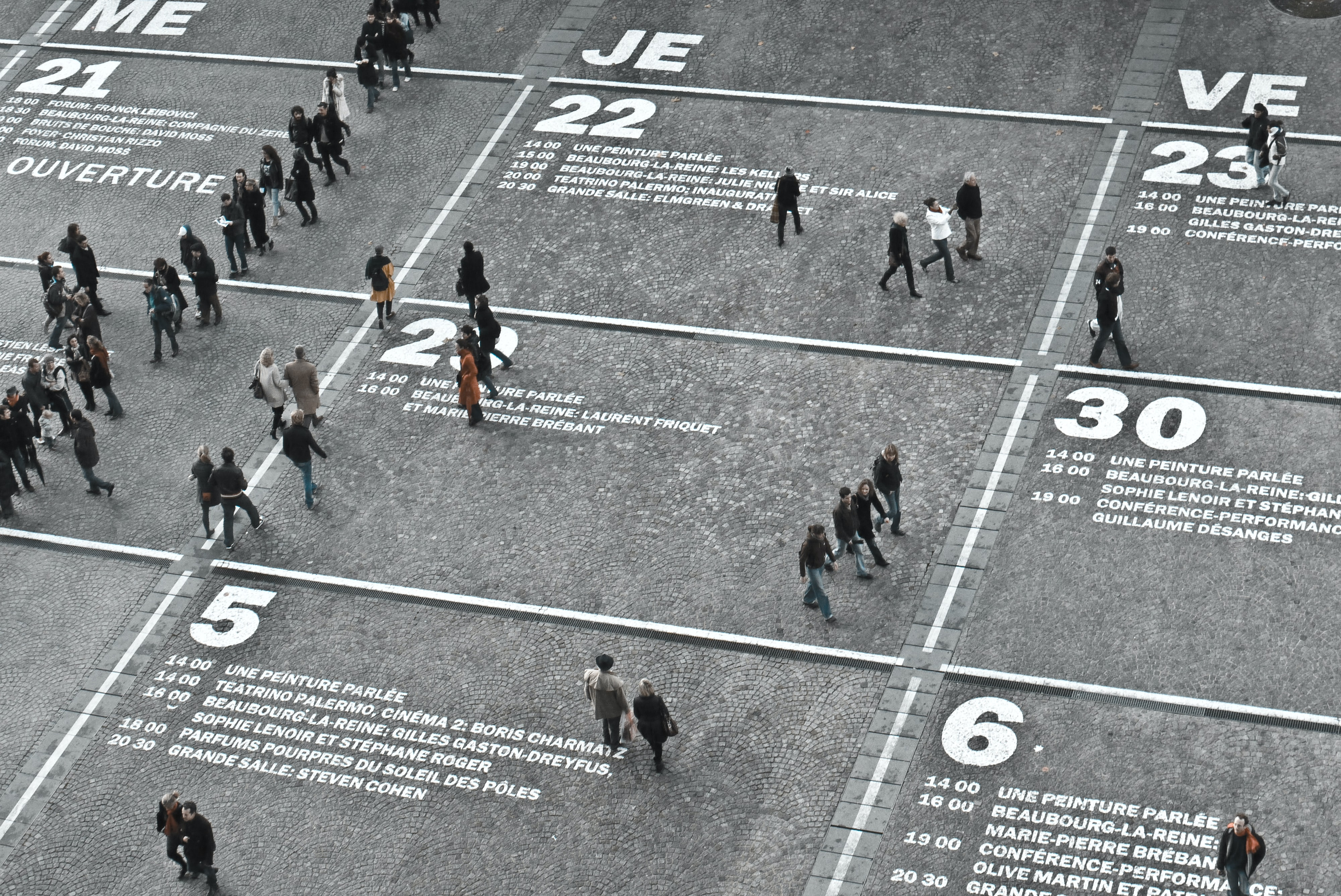 A large field turned into a calendar with a volume of people walking around at The Centre Pompidou