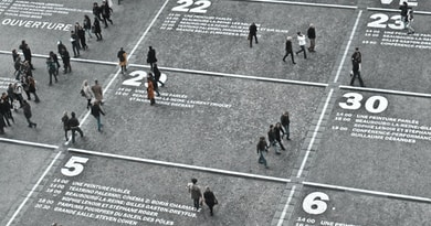 people walking on the road during day time