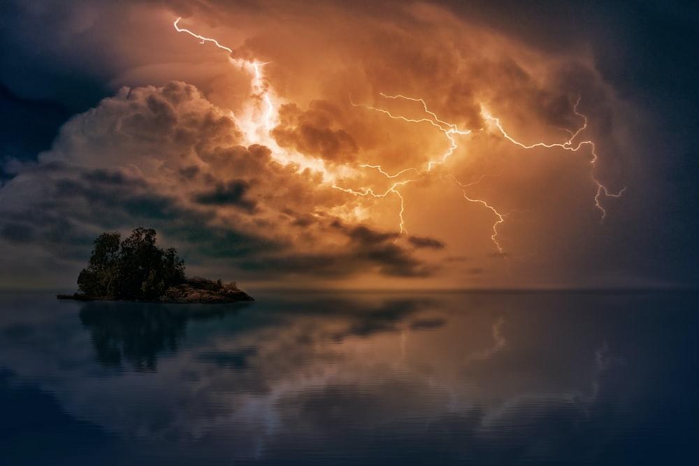 photo of island and thunder