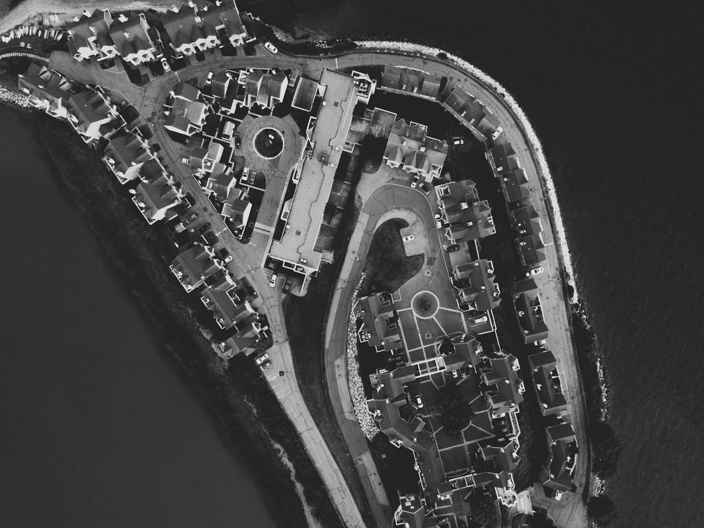 grayscale aerial photography of city islet
