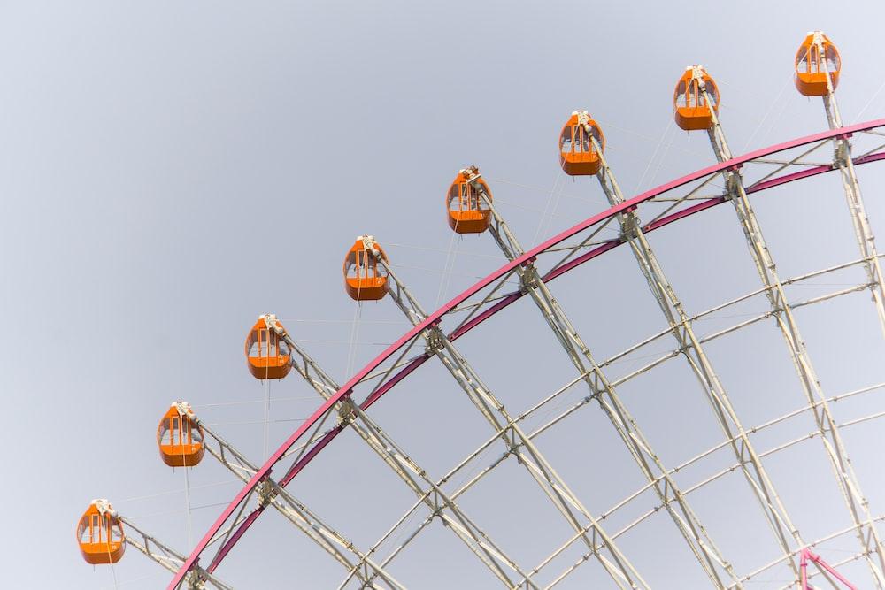 orange and pink ferries wheel