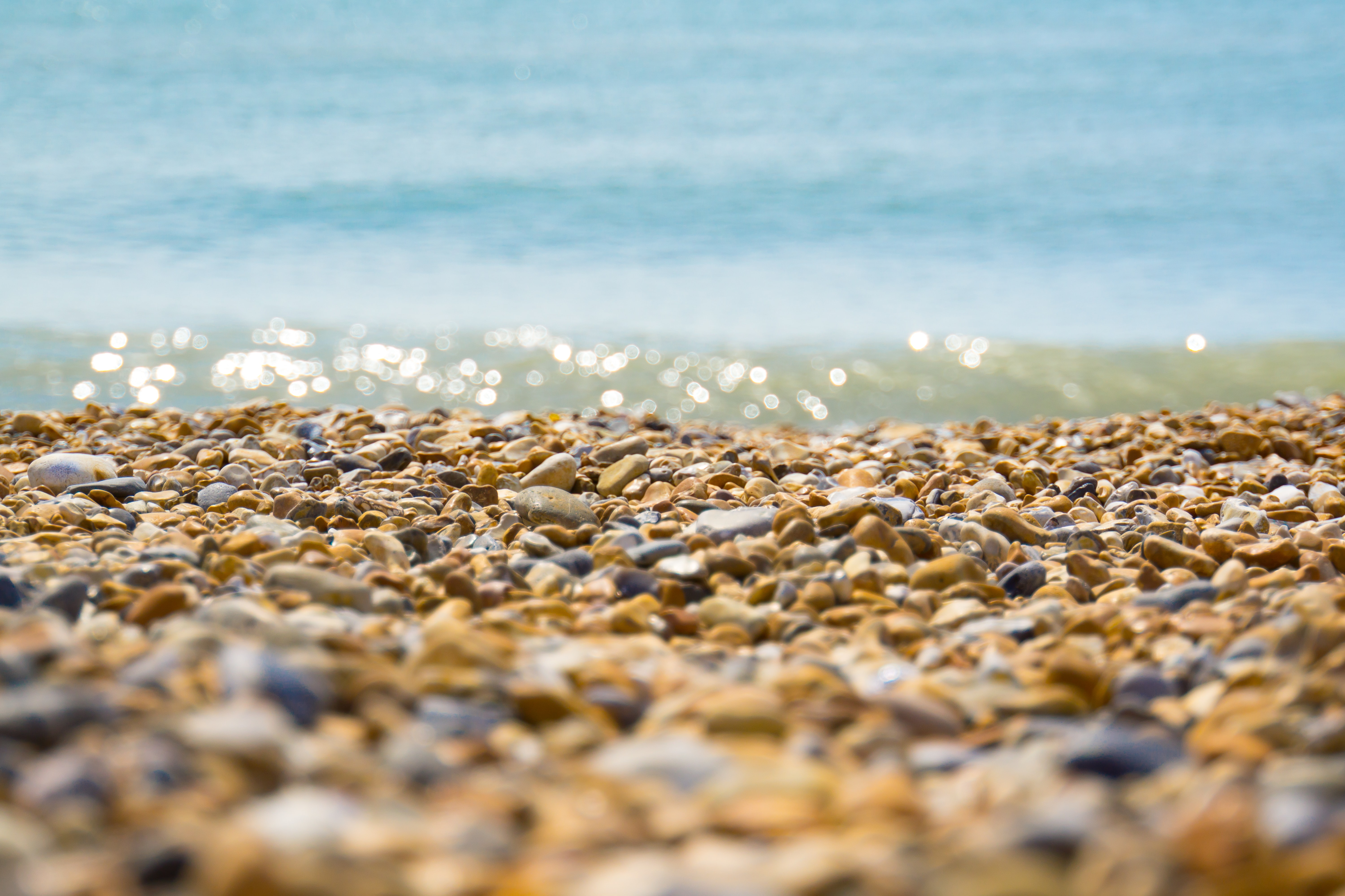 Pebble beach shore washed by the ocean at Brighton