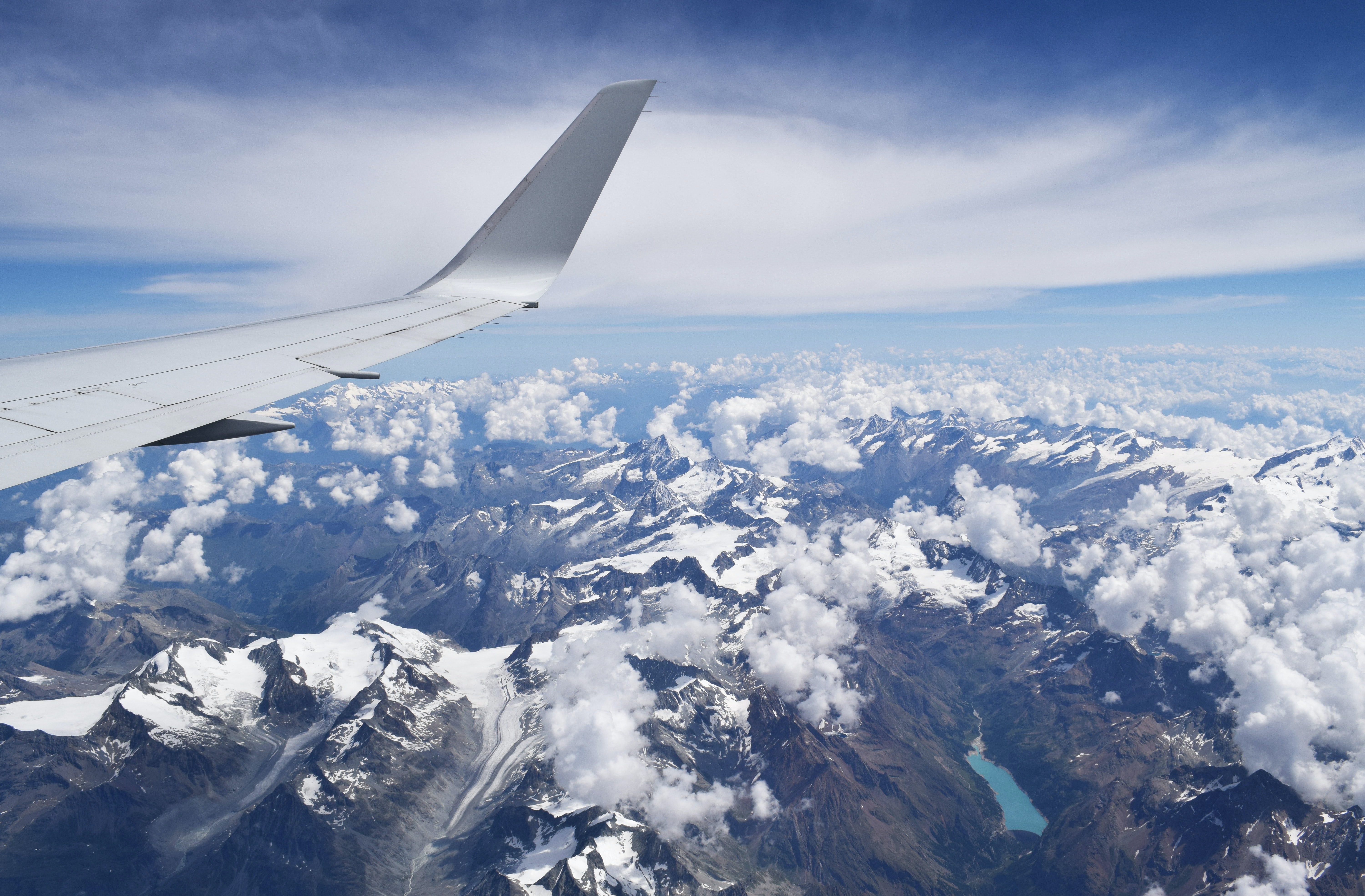 snow covered mountain airplane window view