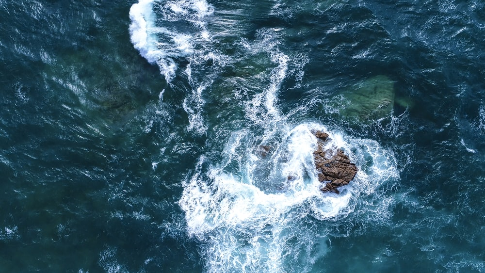 aerial view photography of rock formation in the ocena