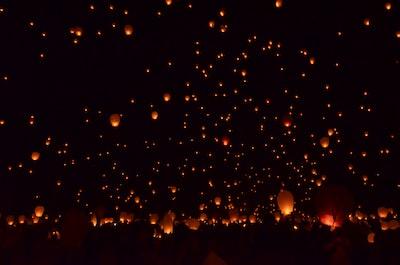paper lantern flying above sky lantern festival teams background