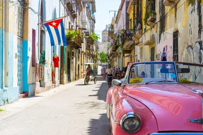 pink convertible car cuba zoom background